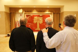 """""""Big Red"""" is on loan for four years from the State Historical Society of Iowa, which received the flag in 1919 from an Iowa Civil War veteran. The flag, shown here on its March 5 arrival on campus, is housed at the Holliday Alumni Center where a museum-quality showcase has been built for the 10- by 7-foot framed flag."""